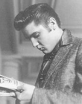 Elvis reading an early print edition of Glorious Noise.