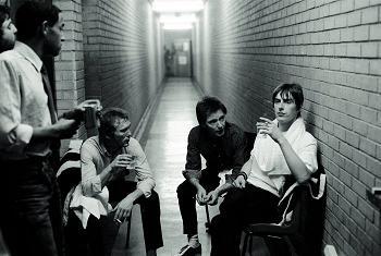 Rick Buckler, Bruce Foxton, and Paul Weller hanging backstage