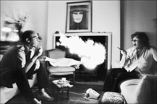 Hunter S. Thompson exhales a mouthful of lighter fluid at Jann Wenner in 1976. Photo by Annie Leibovitz.