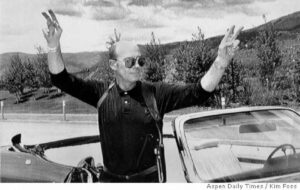 Hunter S. Thompson flashes victory signs